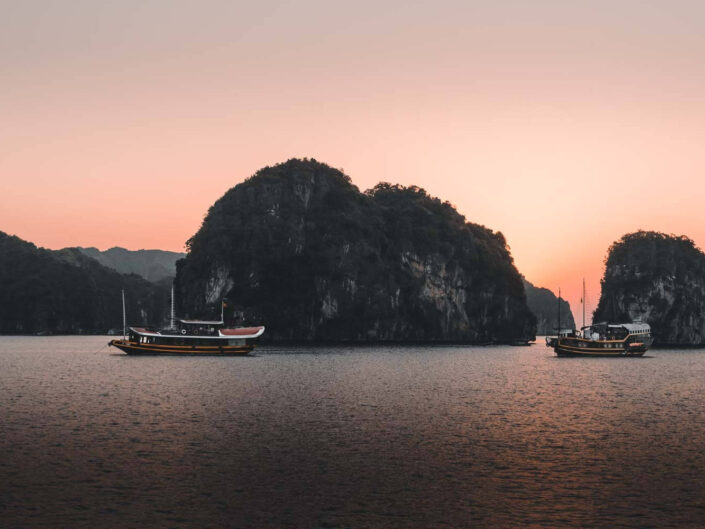Boats at Ha Long Bay in Vietnam during sunset.