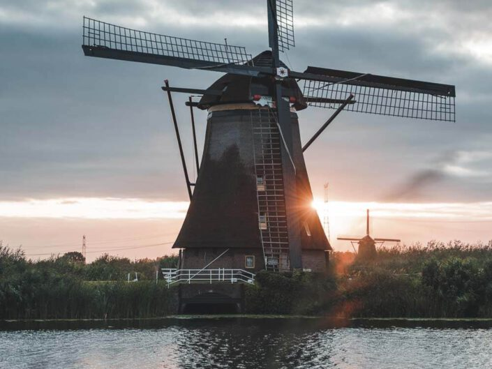 A windmill at kinderdijk during sunrise, the Netherlands.