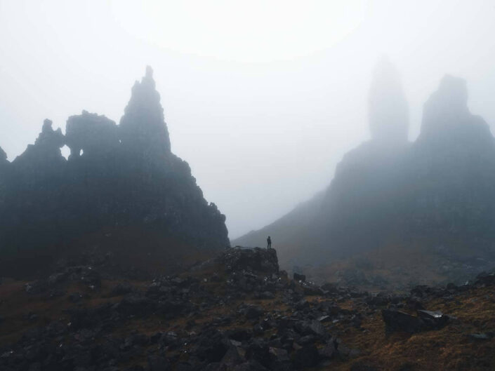 A small person in front of the old man of storr on the isle of skye, Scotland.
