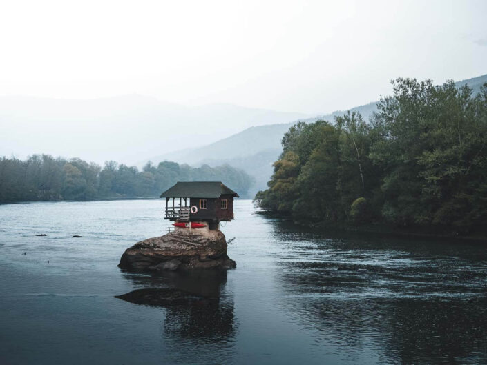 A cabin on a river in Serbia.