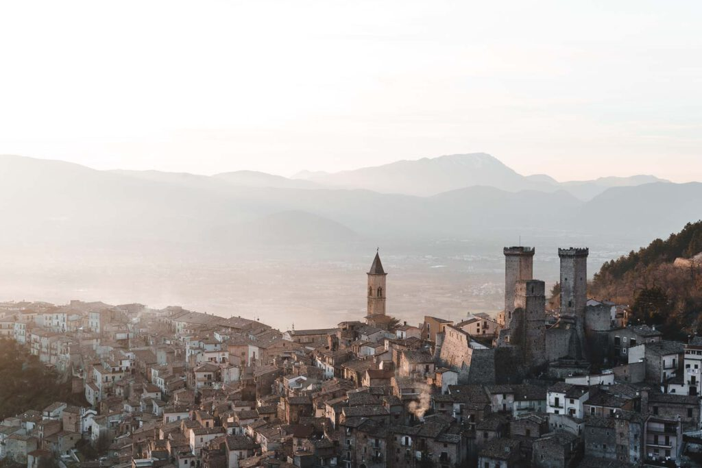 Pacentro, a beautiful old village in the abruzzo mountains of Italy during sunset with a mountain scenery in the background.